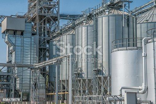 istock Galvanised Iron grain silos on a farm in Eastern Europe 838479578