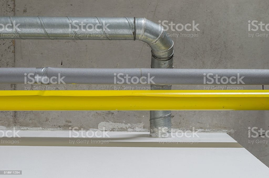 galvanized, grey and yellow pipes, ventilation, water and gas system stock photo