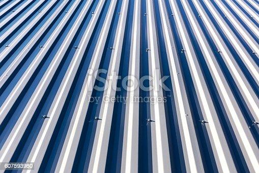 607593268istockphoto galvanized metal steel roof under direct sunlight 607593980