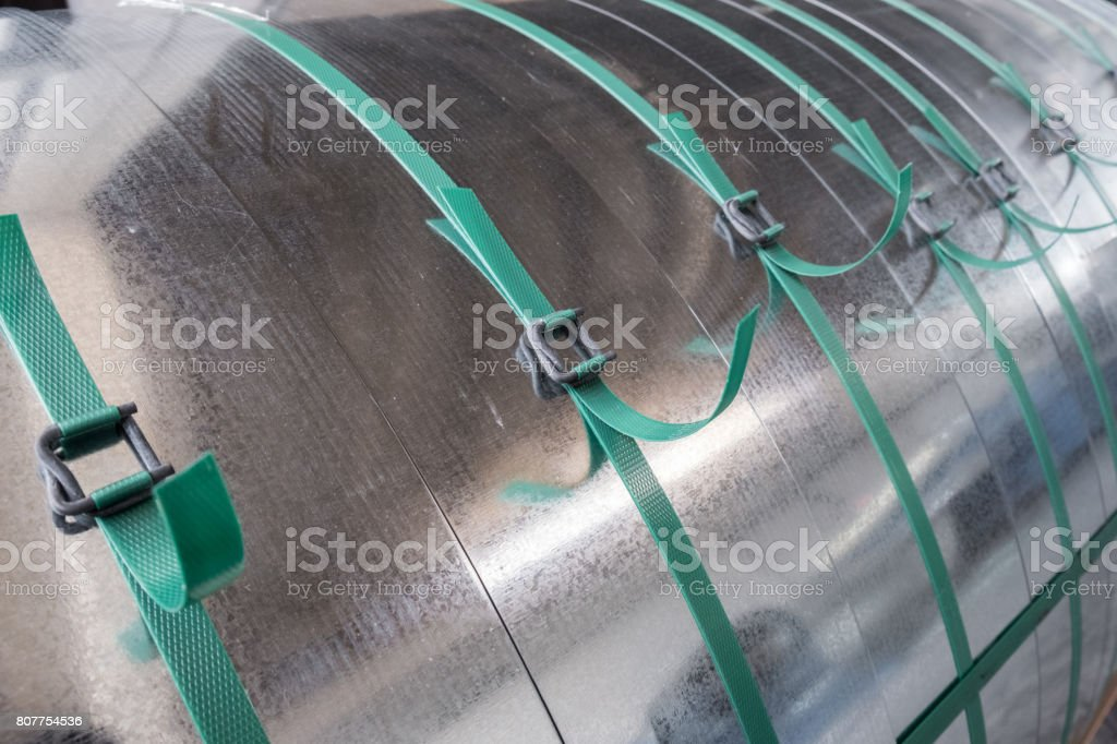 Galvanized steel coils strapped tied stock photo