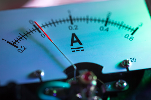 galvanometer in lab illuminated with neon light