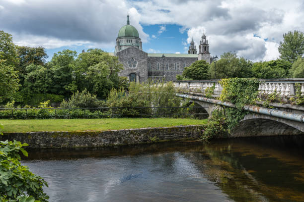 Galway Cathedral and Salmon Weir Bridge, Ireland. stock photo