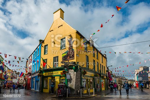 Galway, Ireland - August 07, 2018: People walking along one of the main pedestrian streets in Galway. It is full of shops, pubs and restaurants.