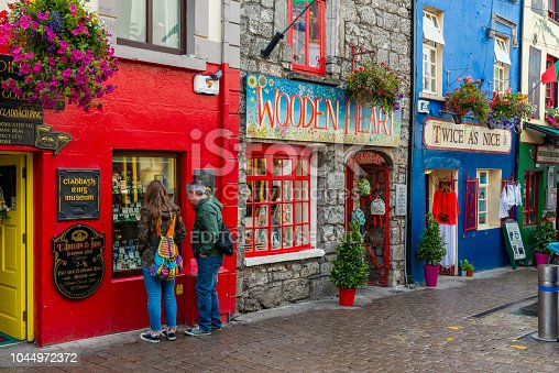 Galway, Ireland - August 07, 2018: Shops, pubs and restaurants along one of the main pedestrian streets in Galway.