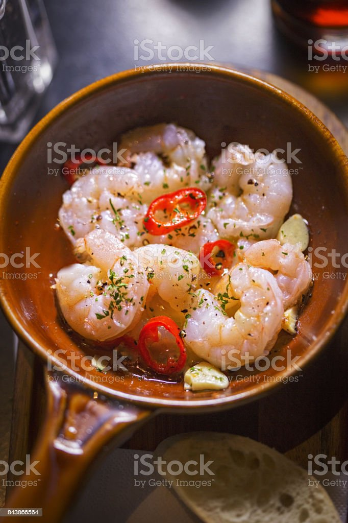 Gambas al Ajillo. Prawns cooked in Virgin Oil with Garlic and Chilli stock photo