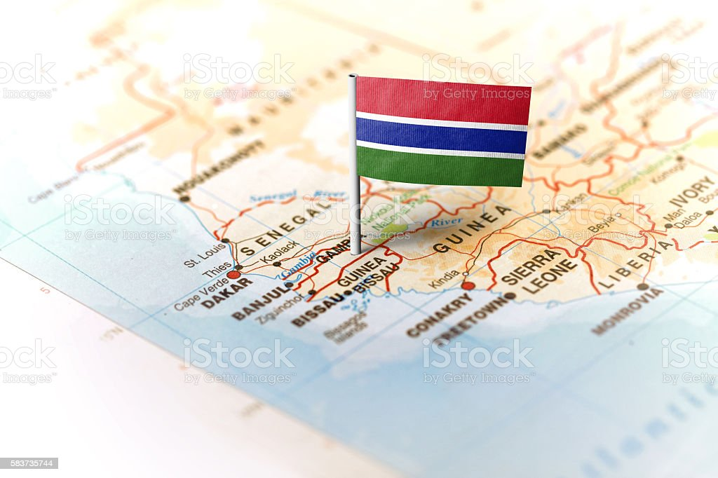 Gambia pinned on the map with flag stock photo