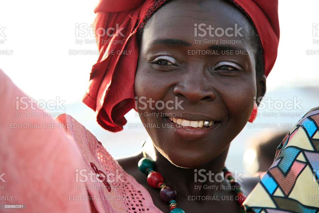 Gambian woman with red and pink outfit stock photo