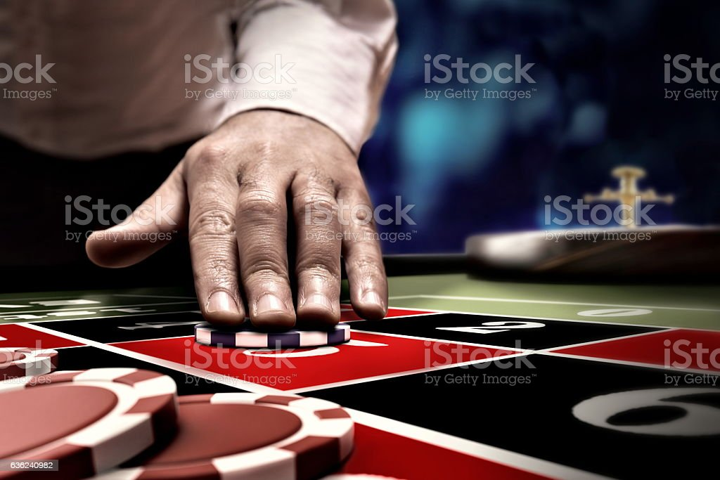 gambler bet on roulette number stock photo