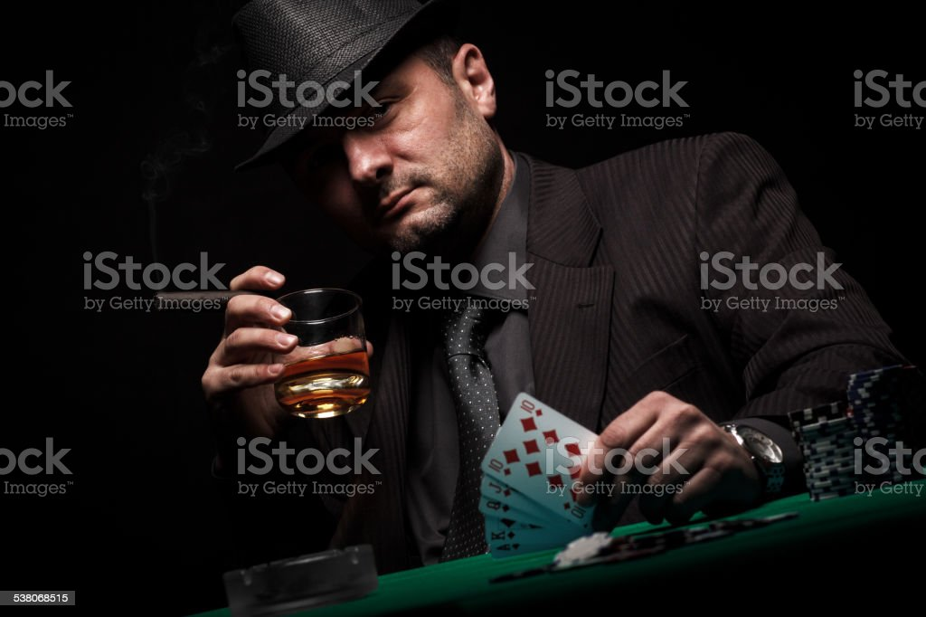 Gambler shows royal flush in his hand. stock photo