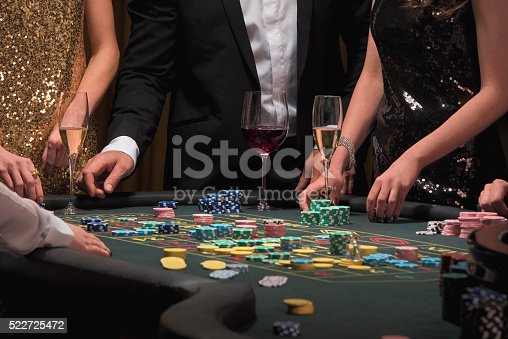 Gamers placing bets at the roulette table in a luxury casino