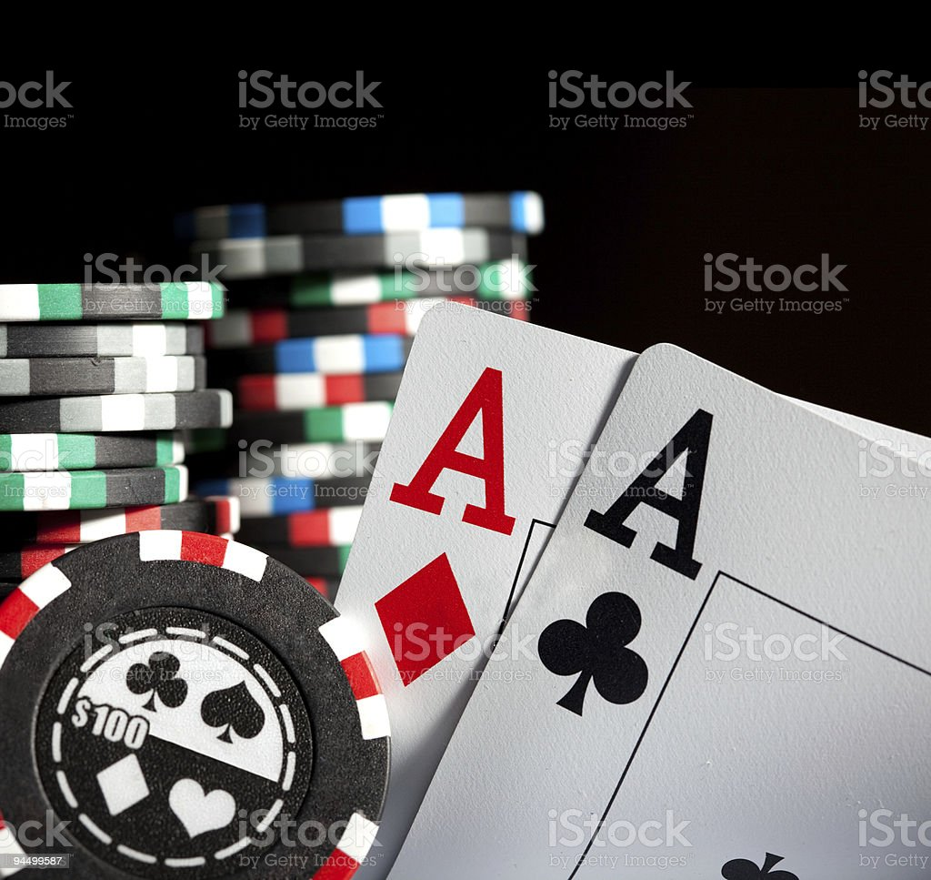 gambling chips and aces stock photo