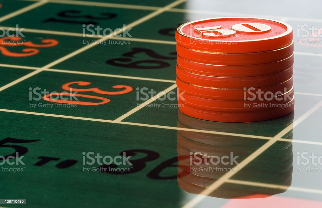 Gambling Chips on a roulette table royalty-free stock photo