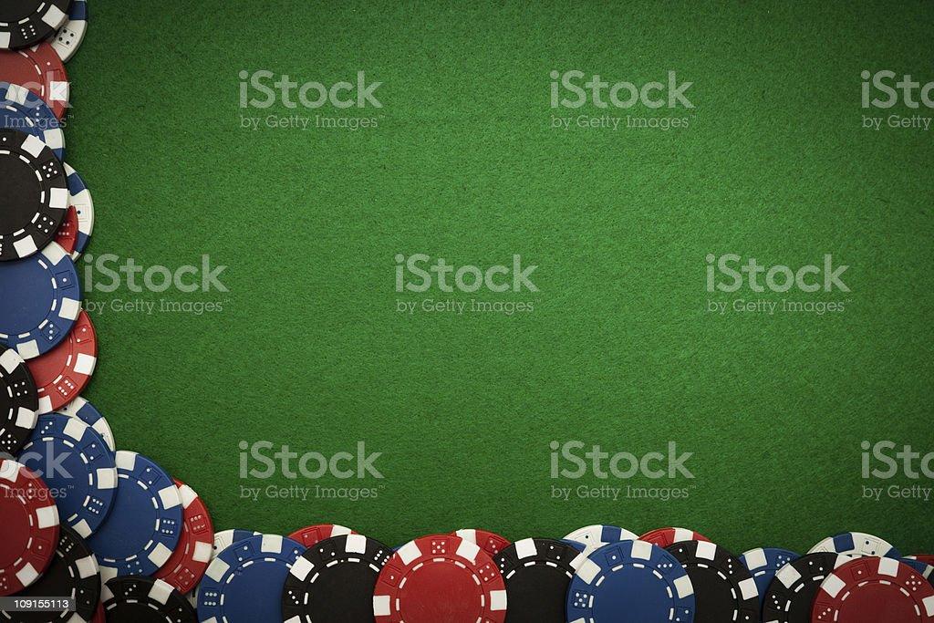 Gambling chips on green felt stock photo