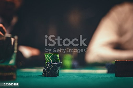 Gambling chips on table in casino.