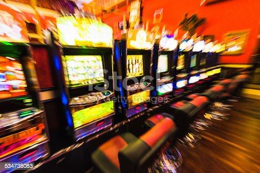 istock Gambling - defocussed row of casino slot machines 534738083