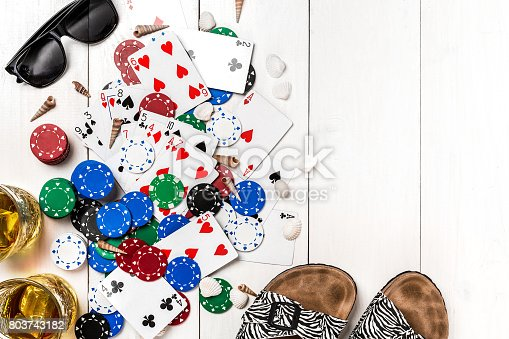 istock Gambling. Poker chips, cards and the dice nearby tablet on wooden table. Top view. Copyspace. Poker 803743182