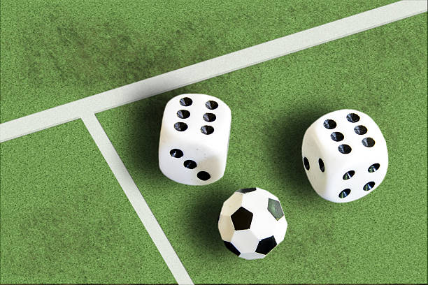 Gambling with dice and football win money stock photo
