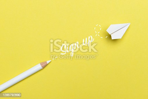 White pencil with Sign Up text and a white paper plane on yellow background.