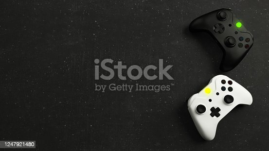 Game competition. White and black joystick with black stone background top view realistic 3D rendering