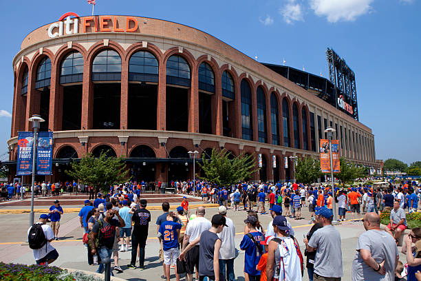 Game Day -Mets Stadium - Queens New York Queens, New York, USA  - July 11, 2015: Met fans in line to head in to Citi Field also known as Mets Baseball Stadium in  Flushing Meadows–Corona Park in Queens (New York City). This stadium Replaced Shea Stadium in  2009 and is the home baseball park of Major League Baseball's New York Mets.  major league baseball stock pictures, royalty-free photos & images
