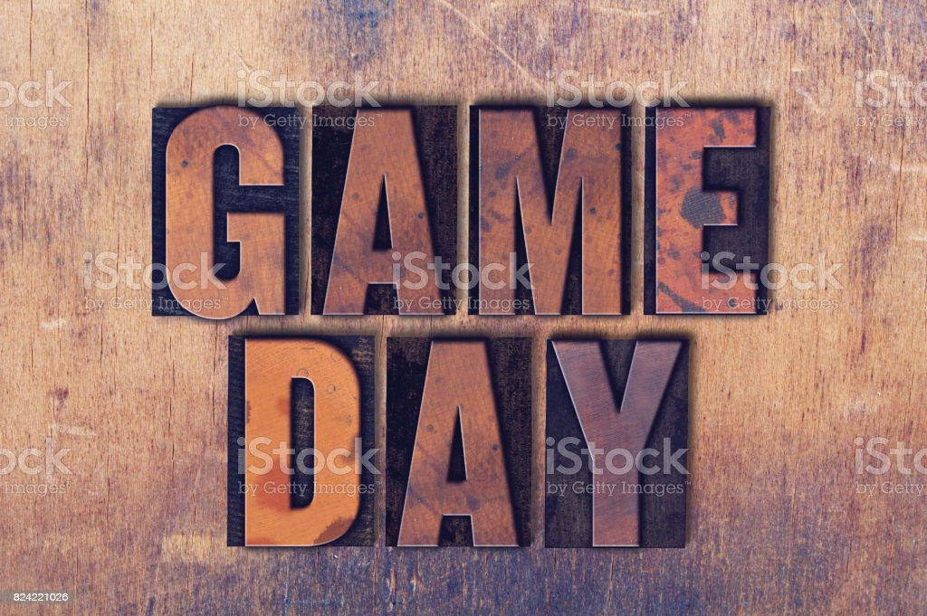 Game Day Theme Letterpress Word on Wood Background stock photo