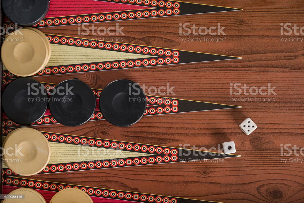 Game field in a backgammon with cubes and counters. stock photo