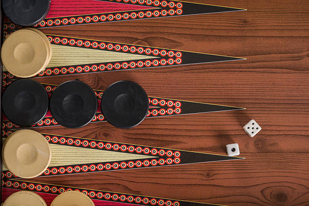 game field in a backgammon with cubes and counters. - backgammon stock pictures, royalty-free photos & images