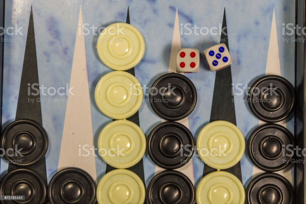 Game field in a backgammon with dice and checkers stock photo