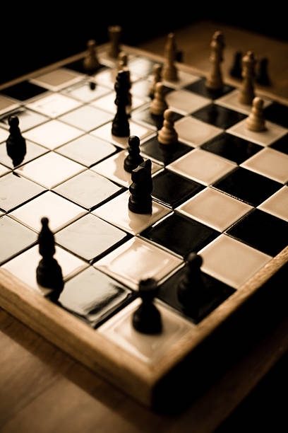 Game of Chess A game of chess in progress, frozen in time adversarial stock pictures, royalty-free photos & images