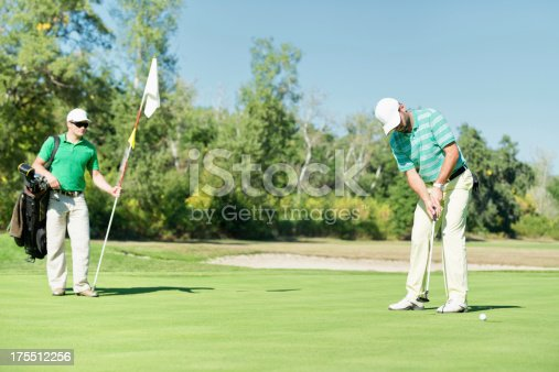 Detail from golf game: making a final putt