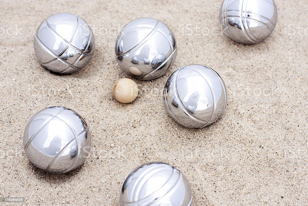 Game of jeu de boule, silver metal balls in sand stock photo
