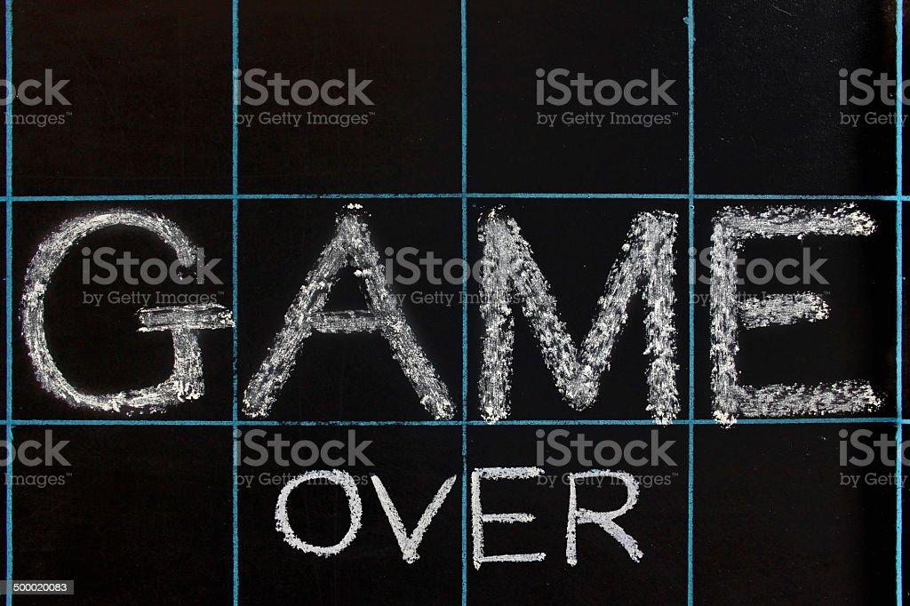 Game over phrase handwritten on black chalkboard royalty-free stock photo