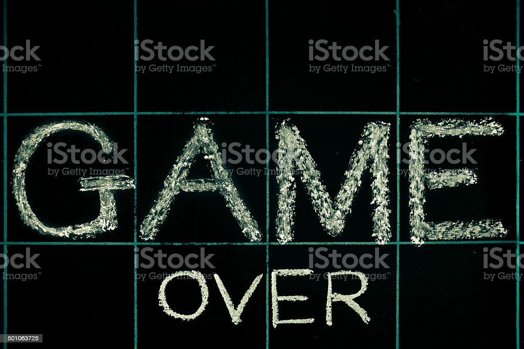 Game over phrase handwritten on black chalkboard royalty-free stock photo