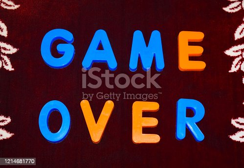 Game over word written with different colored letter blocks arranged on a dark background