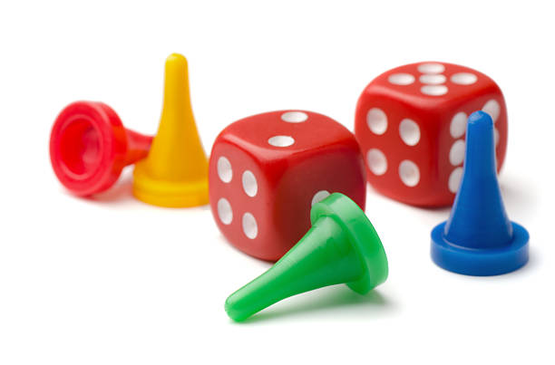 Game pieces and two dice on white background stock photo