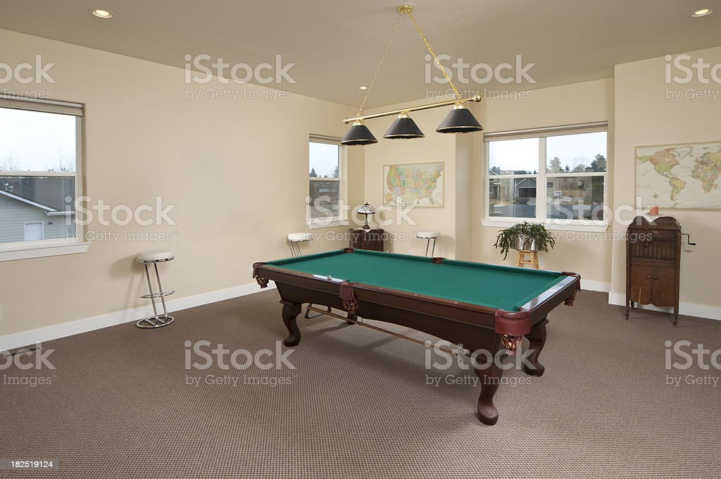 Game room with pool table stock photo