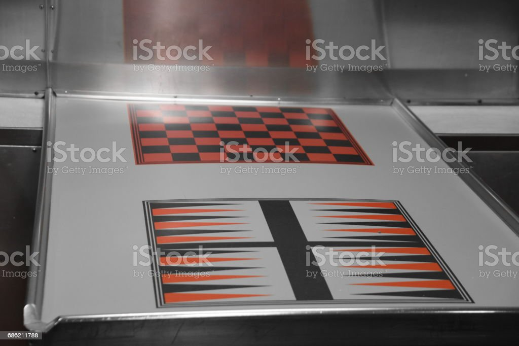 Game tables in the submarine stock photo