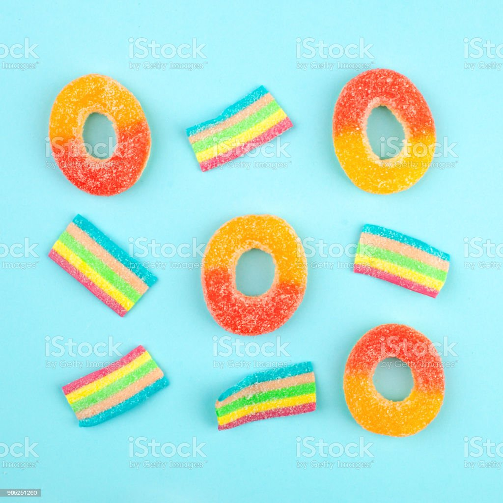 game Tic Tac Toe from candies with jelly and sugar. colorful array of different childs sweets and treats. Bright party background royalty-free stock photo