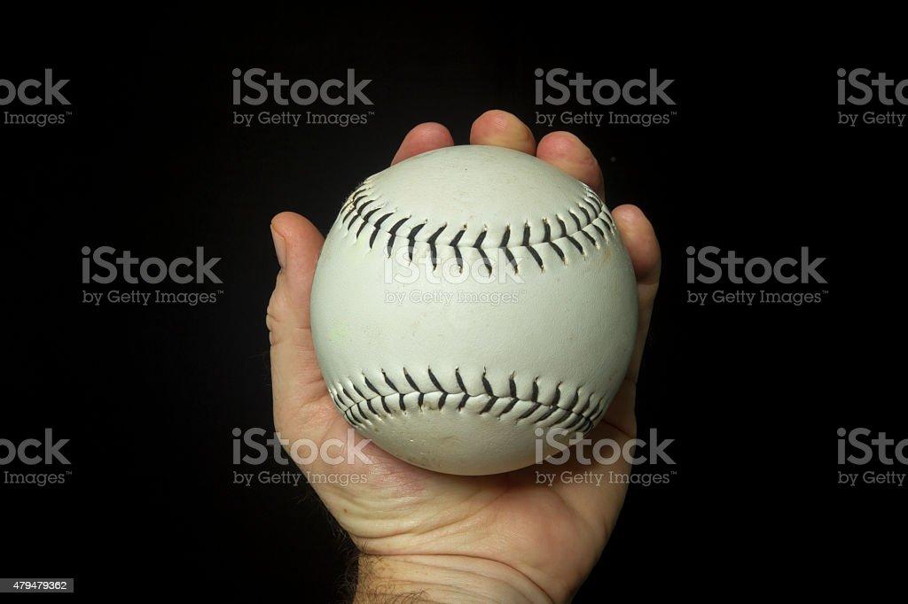 Game Used White Softball In Hand stock photo