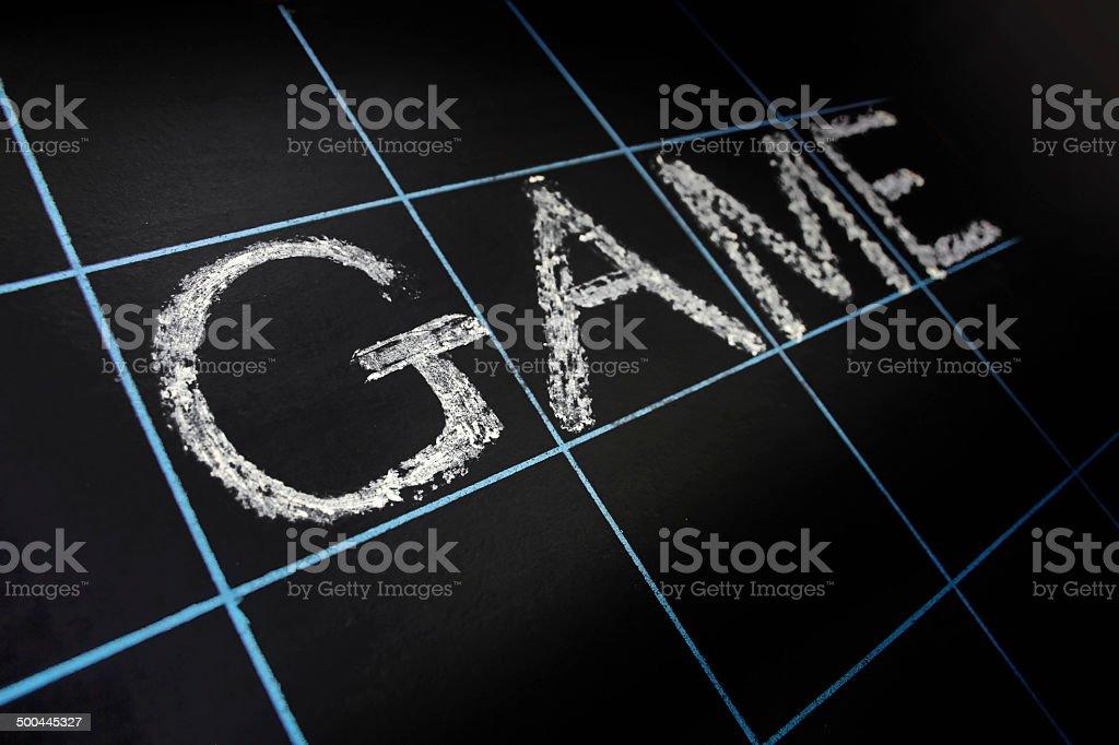 Game word handwritten on black chalkboard royalty-free stock photo