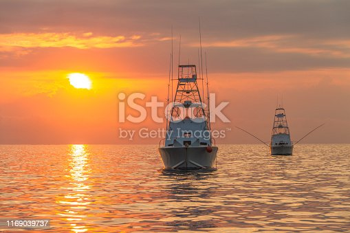 Gameboats on anchor on the Great Barrier Reef at sunrise during the marlin season.