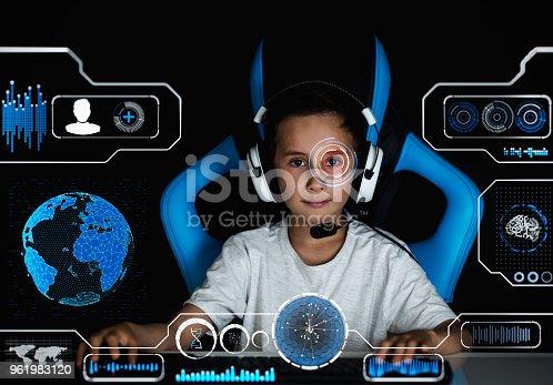 1140560254istockphoto Gamer boy with virtual hud 961983120