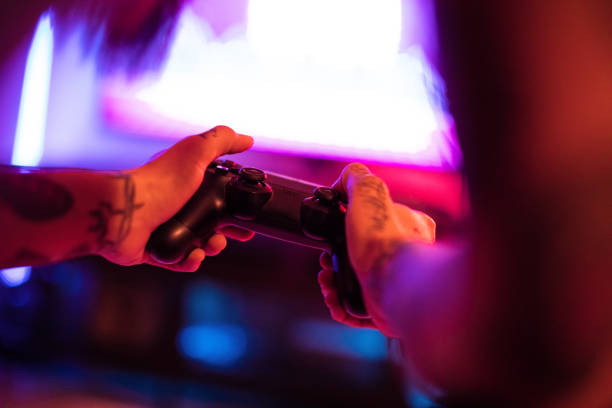 Gamer Hands Gamer Hands gamepad stock pictures, royalty-free photos & images