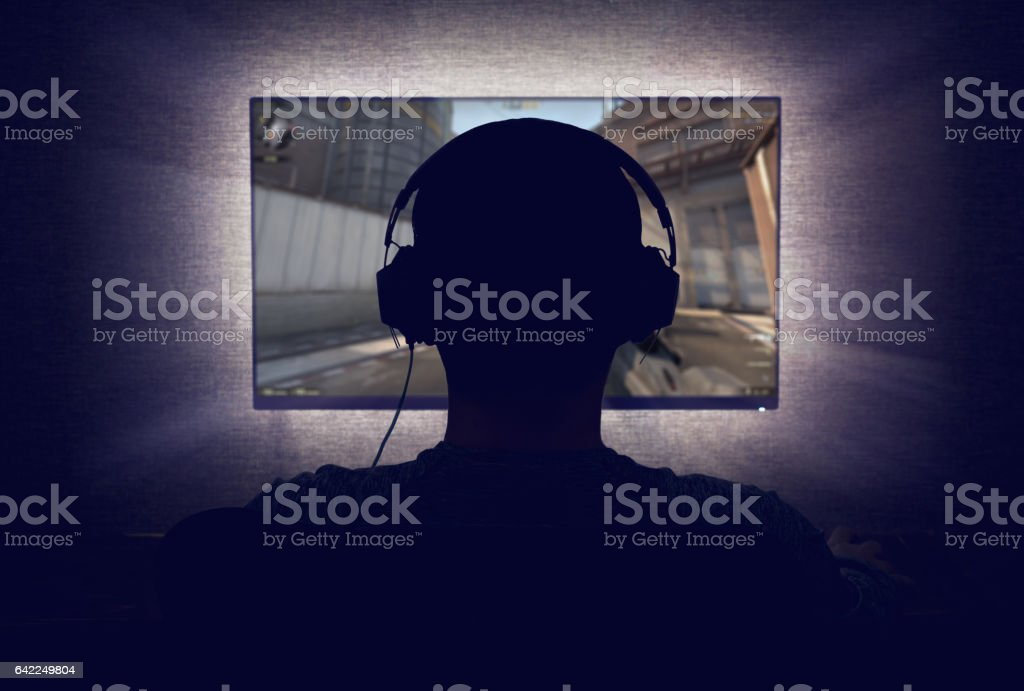 Gamer in front of a blank monitor stock photo