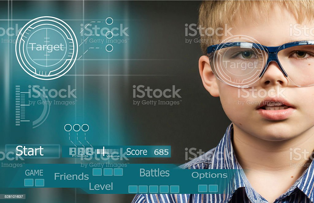 Gamer in virtual glasses near visual screen with game interface. stock photo