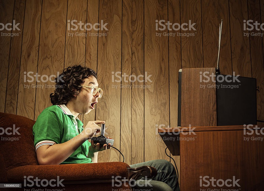 Gamer Nerd Playing Video Games on TV stock photo