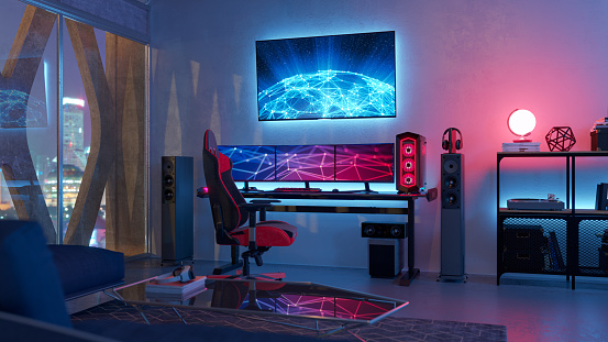 Interior of a gamer room lit with neon lights.