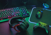 istock gamer work space concept, top view a gaming gear, mouse, keyboard, joystick, headset, mobile joystick, in ear headphone and mouse pad on black table background. 1170073824