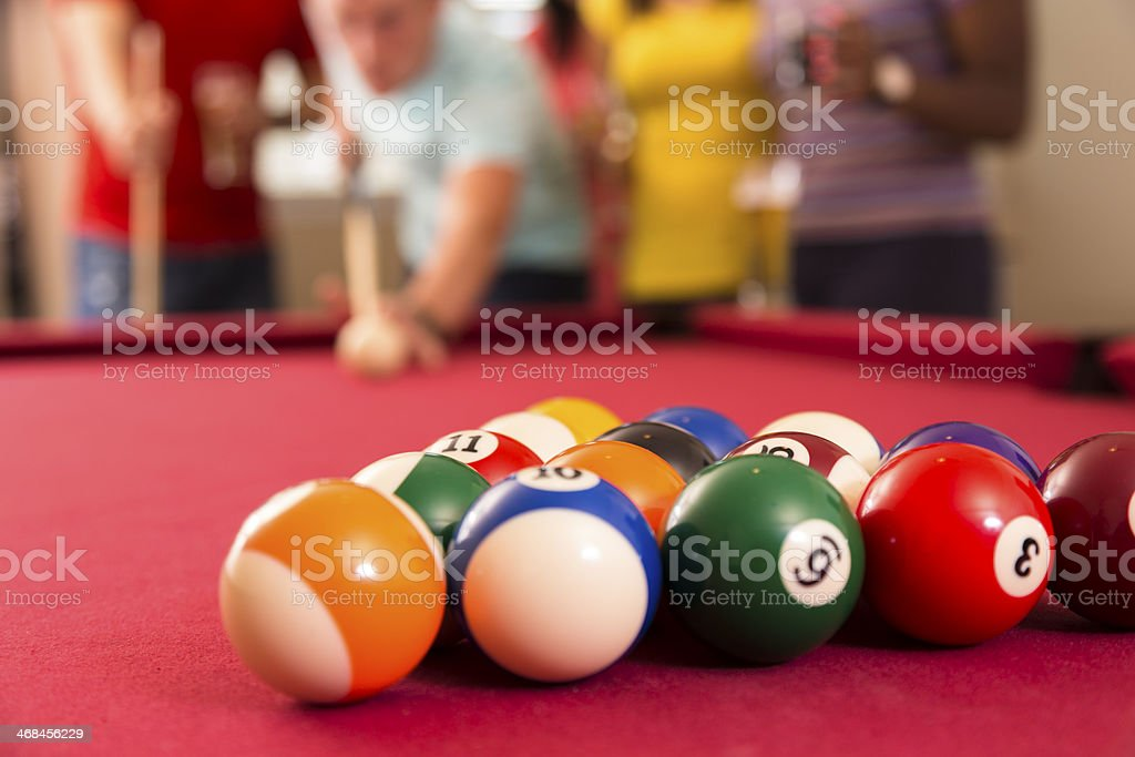 Games: Billiards balls on pool table. Friends ready to break. stock photo