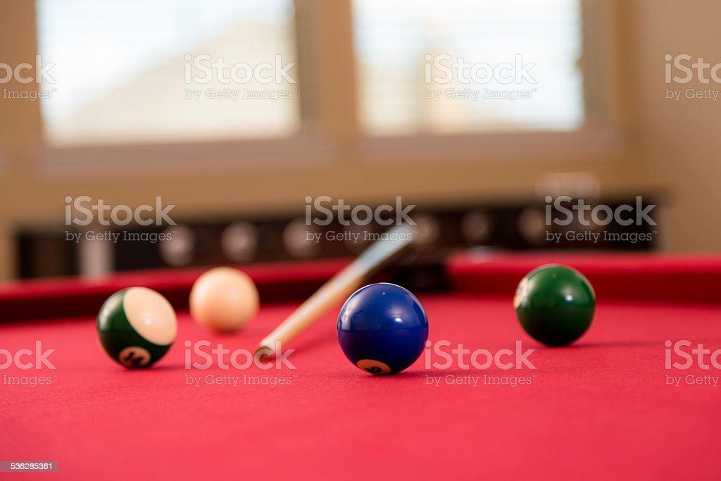 Games: Empty pool table. Cue stick, billards balls. Foosball background. stock photo